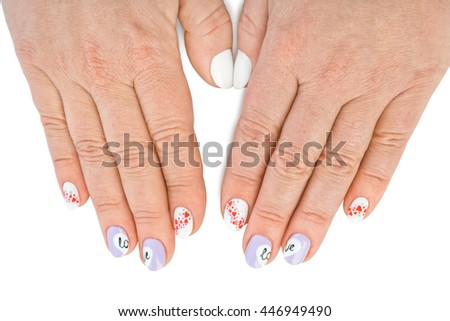 Finger nail with love pattern isolated on white background