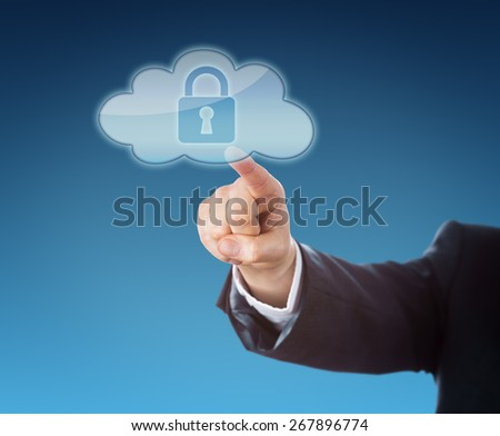 Finger of a corporate person touching a cloud computing icon containing a closed lock symbol. Technology metaphor for secure mobile computing. Arm in dark blue business suit over blue background.