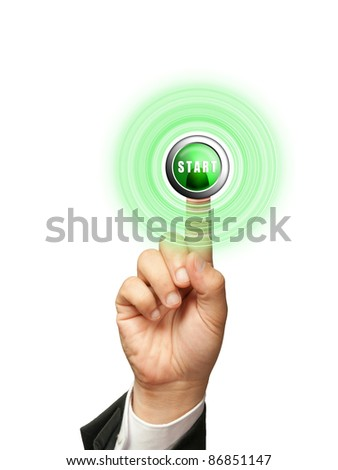 Finger of businessman  pressing START button - stock photo