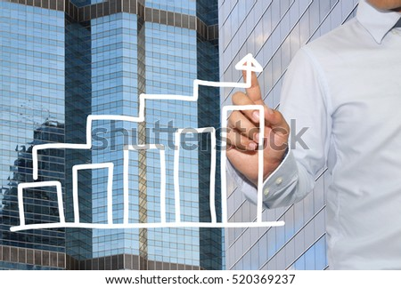 Finger of Businessman touch to bar graph business in peak point,concept of business investment and profits and assessed.