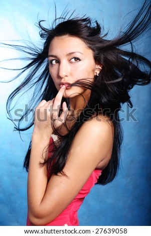 Finger on the lips of a model - stock photo