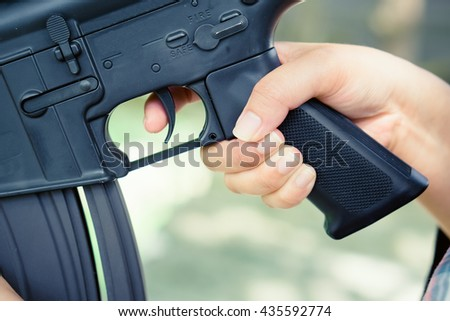 Finger on trigger, Stop War concept.Selective focus. - stock photo