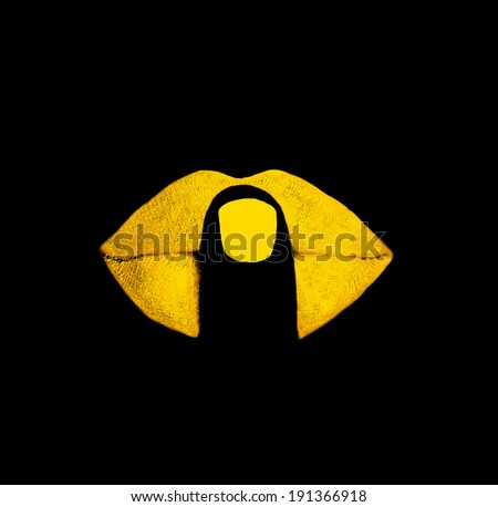 finger on yellow lips at black background - stock photo
