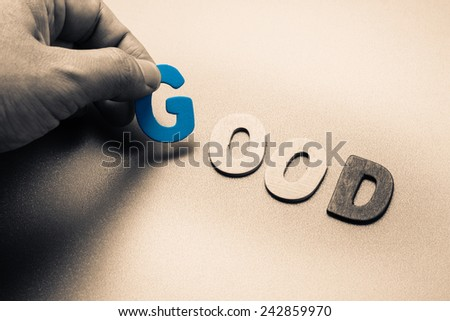 Finger pick a wood letters of Good word - stock photo