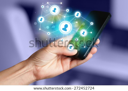 Finger pointing on smartphone with social network illustration
