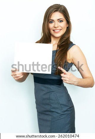 Finger pointing. Smiling business woman hold white card. White board. Isolated portrait.