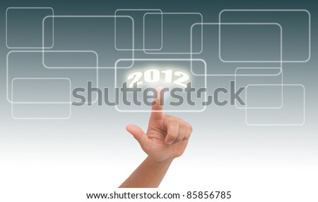 Finger pressing a touchscreen button to 2012
