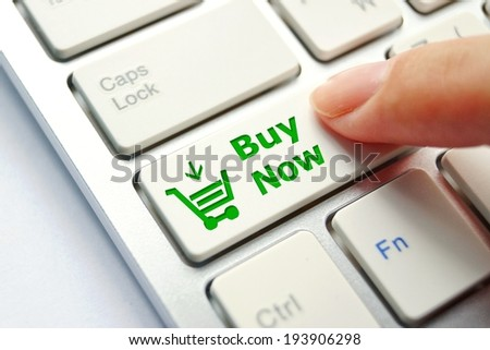 finger pressing computer keyboard button with shopping cart symbol - online shopping concept - stock photo