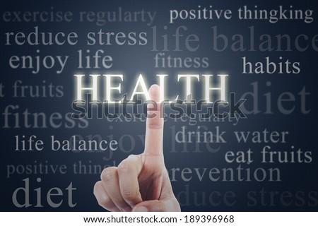 Finger pressing health word on futuristic interface - stock photo