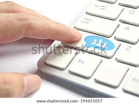 finger pressing social network button