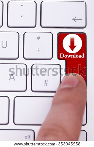 Finger pressing the red download button on keyboard. Torrent and p2p. Digital data transfer - stock photo