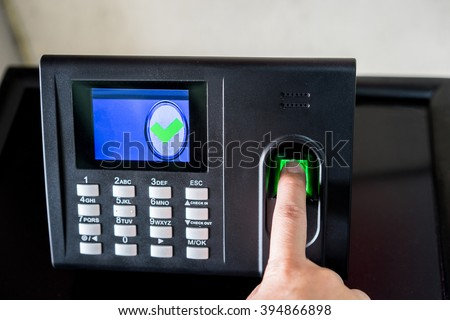 Finger print scan for enter security system - stock photo