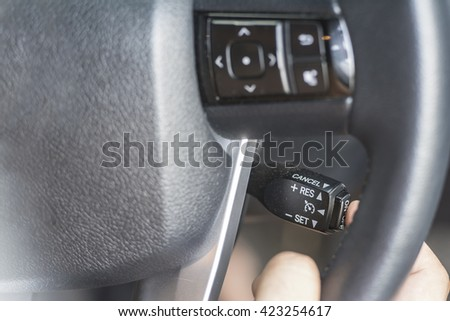 Finger Push a button on the car steering wheel
