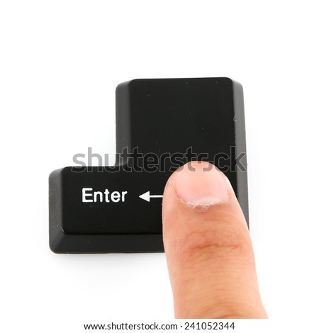Finger pushing the button enter of keyboard. - stock photo
