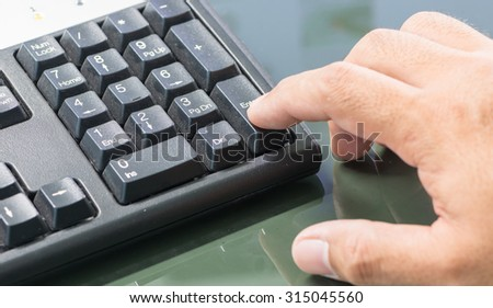 finger put on enter botton keyboard.