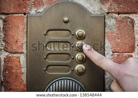 finger ringing a door bell - stock photo