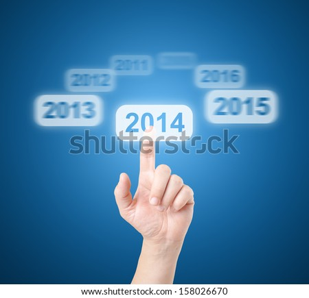 Finger selects touchscreen 2014 - stock photo