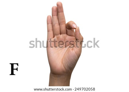 Finger Spelling the Alphabet in American Sign Language (ASL). The Letter F - stock photo