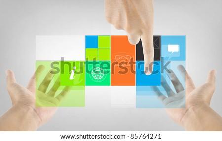 finger touching program application on hand - stock photo