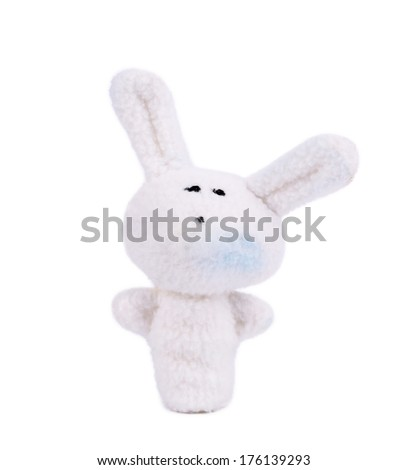 Finger toy of white rabbit. Isolated on a white background.