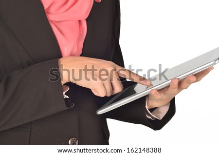 finger woman  presses on the touch screen - stock photo