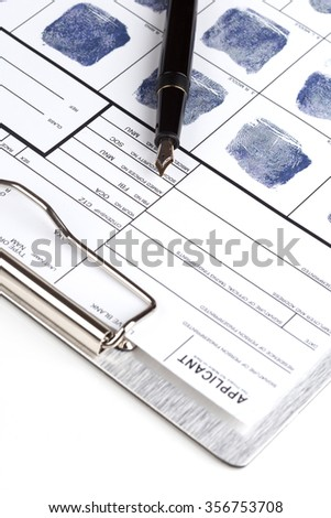 Fingerprint card with fountain pen over clipboard - stock photo