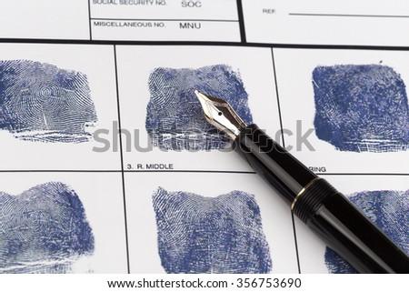 Fingerprint card with vintage fountain pen  - stock photo