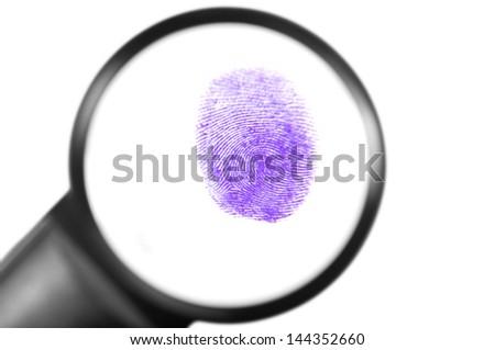 Fingerprint viewed through a magnifying glass - stock photo