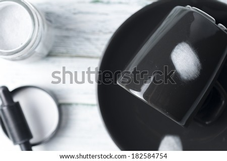 Fingerprints developed with magnetic white cup dark - stock photo