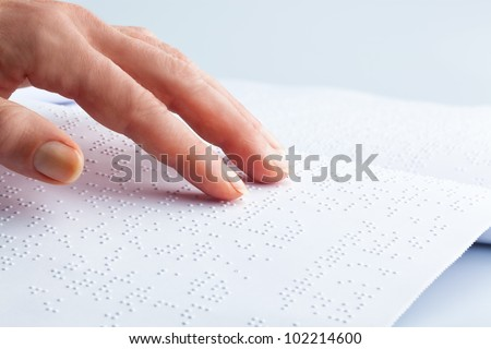 fingers and braille. blind people read a book in braille. - stock photo