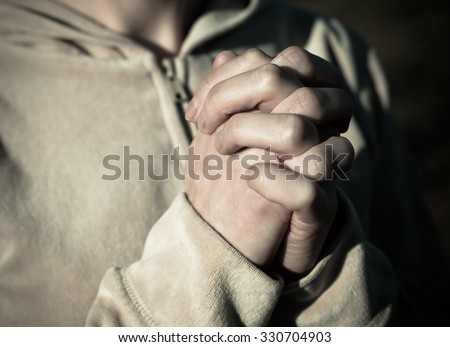 Fingers crossed female hands with each other. Prayer.