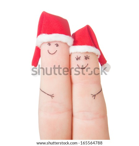 Fingers faces in Santa hats isolated on white background. Happy couple celebrating concept for Christmas day. - stock photo