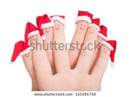 Fingers faces in Santa hats isolated on white background. Happy family celebrating concept for Christmas day.