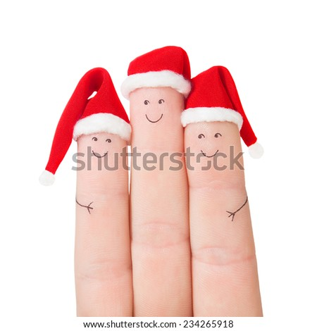 Fingers faces in Santa hats isolated on white background. Happy family celebrating concept for Christmas or New Years day - stock photo