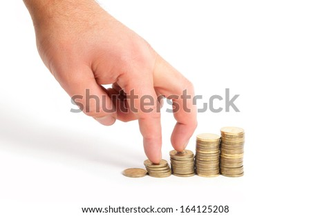 Fingers go up by stakes of coins