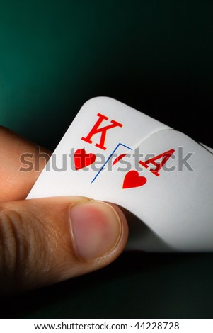 Fingers holding winning card - stock photo