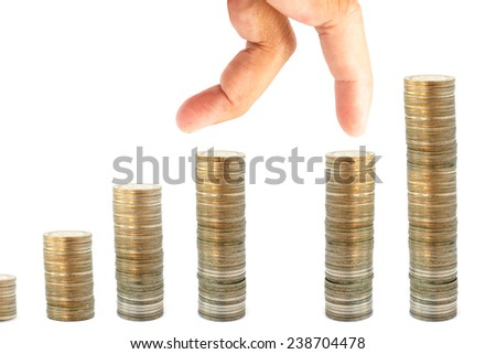 fingers jumping up on piles of coins money concept