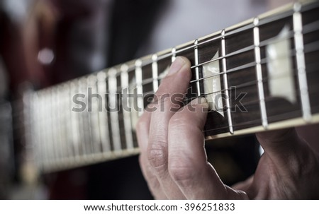 Fingers over guitar