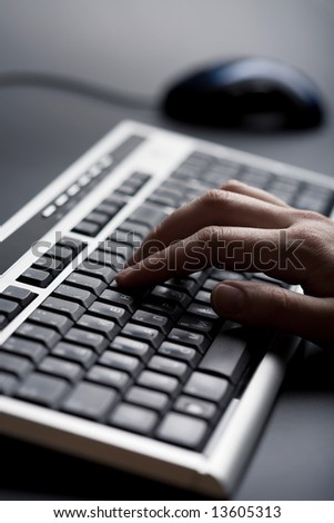 fingers over keyboard