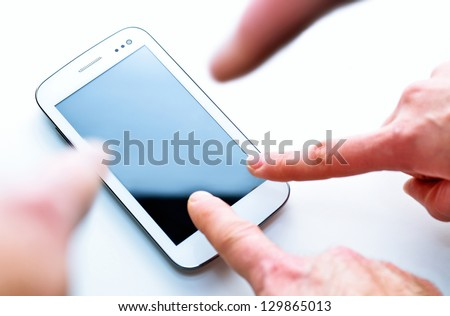 Fingers pointing at something on screen smart phone with focus on the smart phone