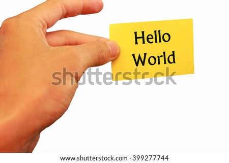 fingers that hold little notes yellow background with a white color bearing the word Hello World - stock photo