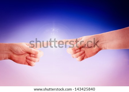 Fingers touching. - stock photo