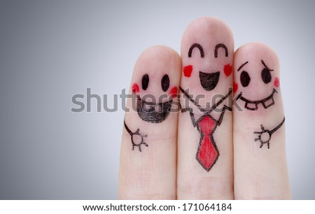 Fingers with happy smiley face - stock photo