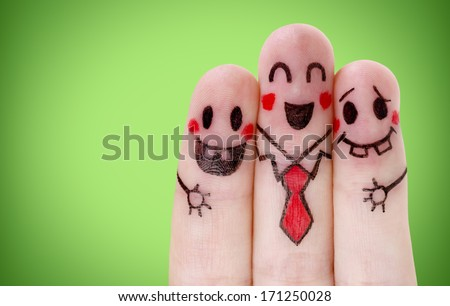 Fingers with happy smiley face on green - stock photo