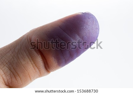 Fingers with ink. - stock photo