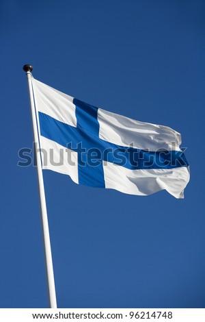 Finish Flag towards Blue sky - stock photo