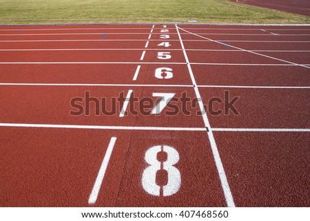 Finish line on a freshly renewed running tracks. - stock photo
