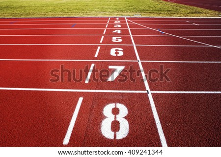 Finish line on a freshly renewed running tracks. Image has a vintage effect applied. - stock photo