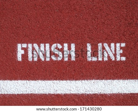 Finish line - sign on the running track - stock photo