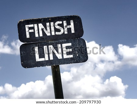 Finish Line sign with clouds and sky background - stock photo
